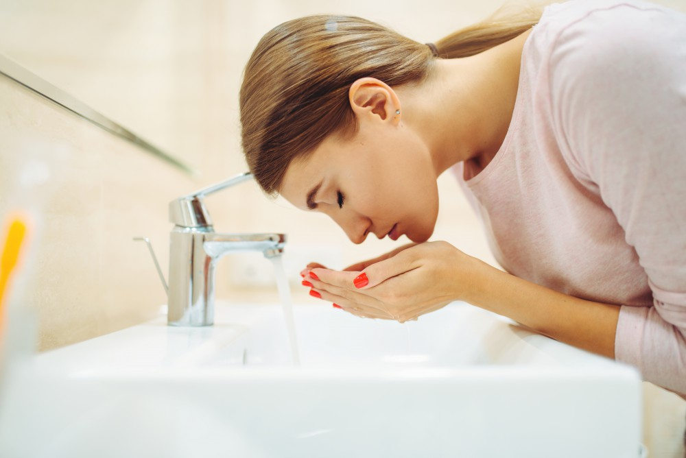 washing face with natural ingredients