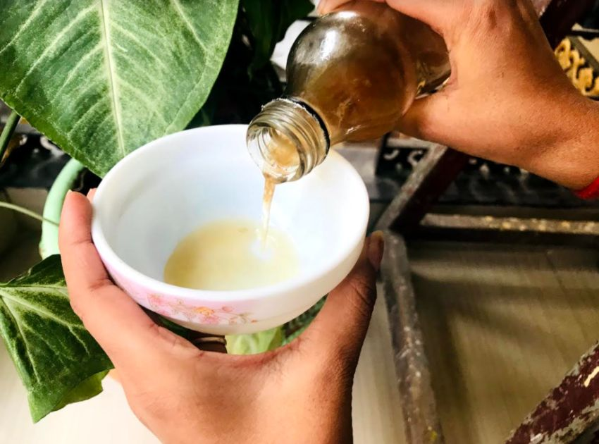 adding apple cider vinegar to the bowl