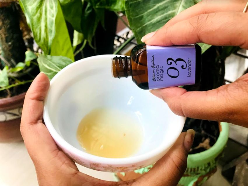 adding lavender essential oil to the bowl