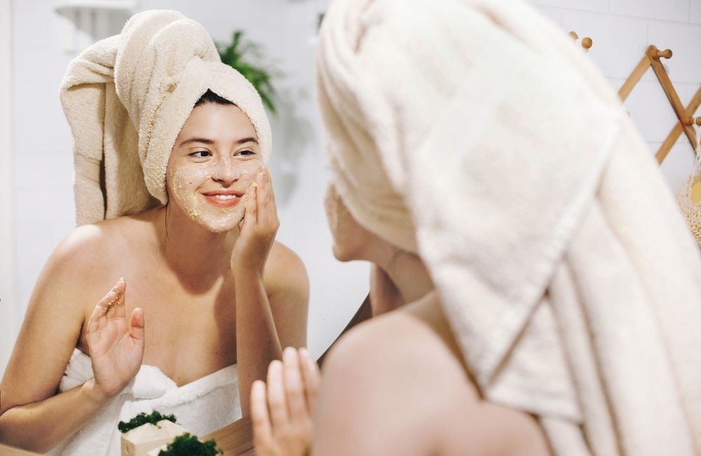 girl scrubbing and exfoliating face skin - Easy Beauty Tricks